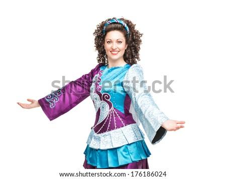 Young woman in irish dance dress welcoming - stock photo