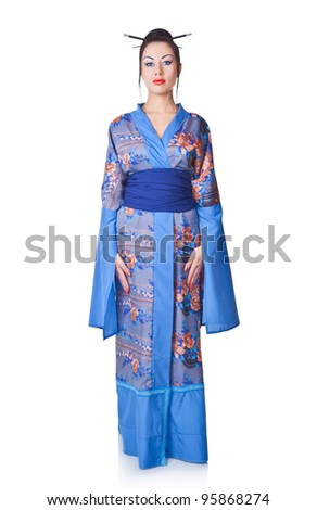 Young woman in Japanese kimono isolated on white background - stock photo