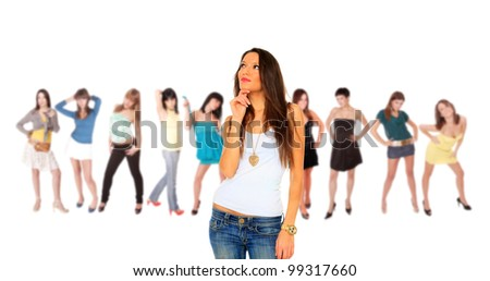 Young woman in jeans standing in front of a group of girls - stock photo