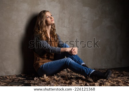 Young woman in jeans with autumn leaves. Fashion shot - stock photo