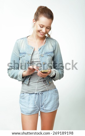 Young Woman in Jeans with Smartphone - stock photo