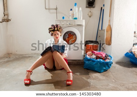 young woman in laundry, she waits - stock photo