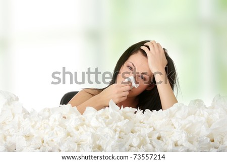Young woman in lot of tissues around