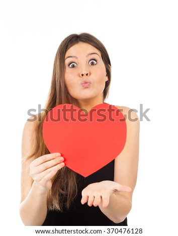 young woman in love with a heart in hand - stock photo