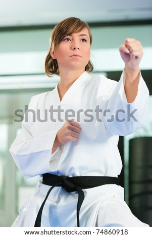 Young woman in martial art training in a gym - stock photo