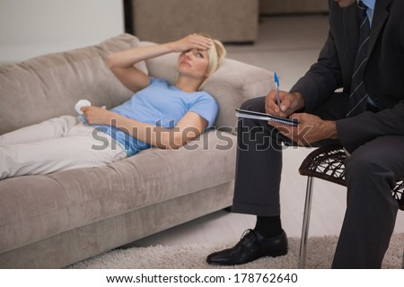 Young woman in meeting with a male psychologist in his office - stock photo
