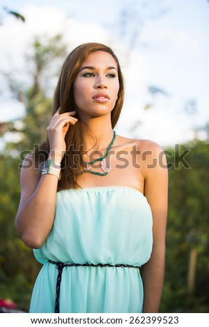 Young woman in nature looking away