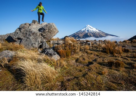 Young woman in New Zealand scenery - stock photo