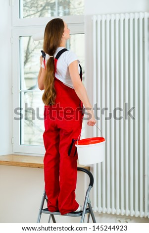 Young woman in overall renovated because she moved to their new or old home