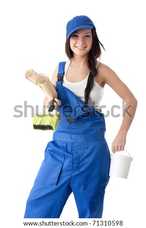 Young woman in overalls with wall-paper, glue and brush on a white background.