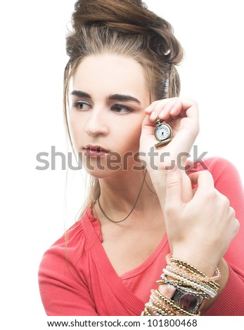 Young woman in pink dress and in with watch