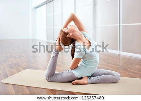 Young woman in position indoors - stock photo