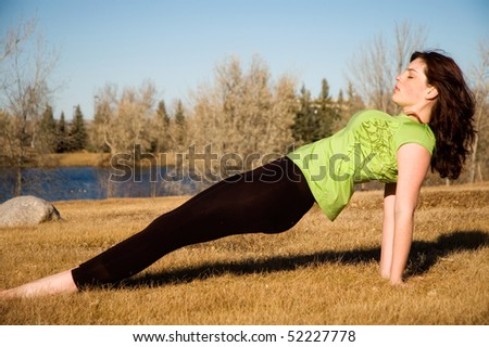 Young woman in purvottanasana yoga pose.