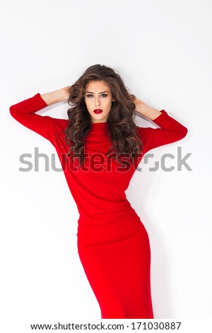 young woman in red dress studio shot