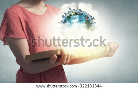 Young woman in red dress with book in hand. Elements of this image are furnished by NASA - stock photo