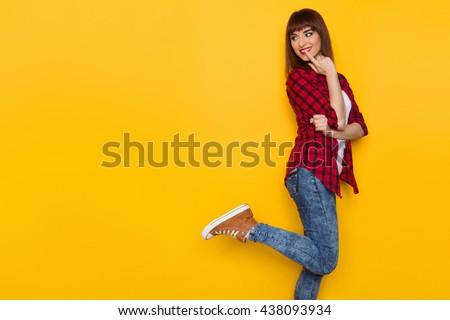 Young Woman In Yellow Hardhat Orange Reflective Vest Lumberjack Shirt Jeans Black