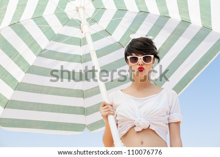 young woman in retro style by color umbrella - outdoors