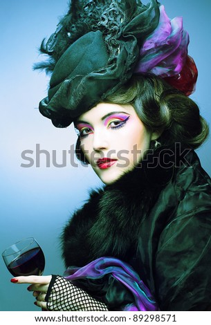 Young woman in retro style with glass of red wine. - stock photo