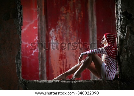 Young woman in ruined building. Contrast colors. - stock photo