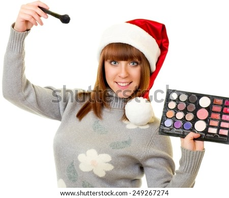 Young woman in Santa Claus clothes with beauty cosmetics on white background. - stock photo
