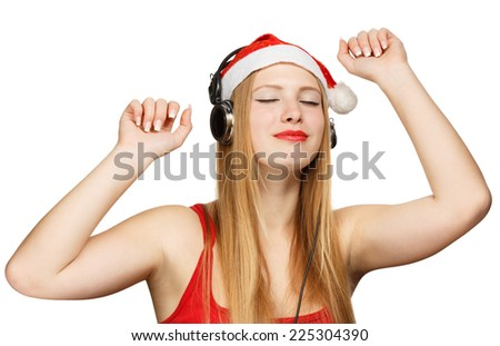 Young woman in santa claus hat and headphones take pleasure from music isolated on white background - stock photo