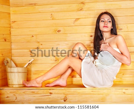 Young woman in sauna. - stock photo