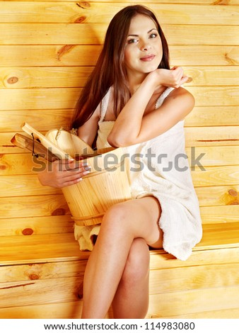 Young woman in sauna. Healthy lifestyle. - stock photo