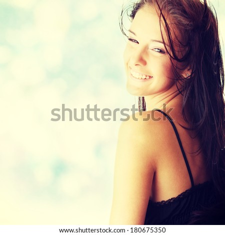 Young woman in sexy black lingerie dancing with wind.  - stock photo