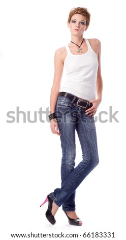 young woman in shirt and jeans on white background