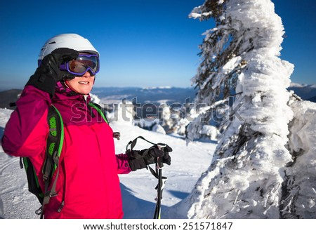 Young woman in ski resort in winter sunny day