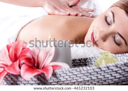 Young woman in spa salon having body relaxing massage.