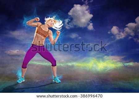 young woman in sport dress at a fitness exercises like aerobics - stock photo