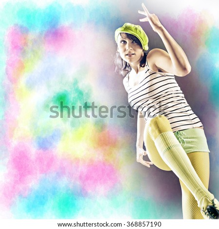 young woman in sport dress dancing in reggaeton or hiphop style - stock photo