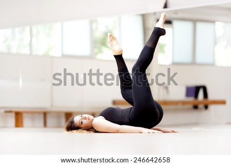 Young woman in sports  - stock photo