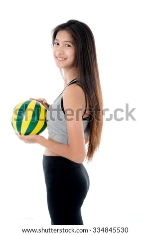 Young woman in sports wear holding  ball. All on white background. - stock photo