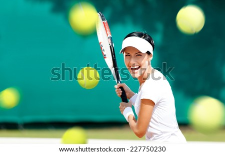 Young woman in sportswear plays tennis at contest - stock photo