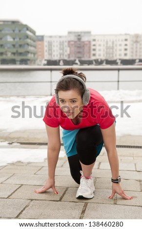 young woman in start position