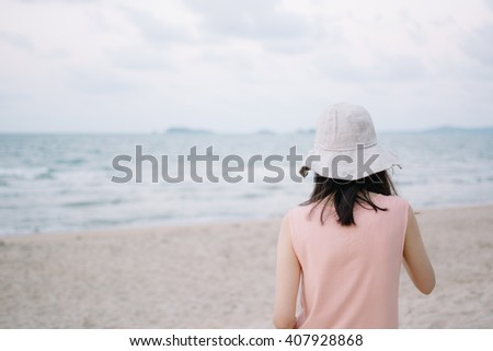 Young woman in summer on a beach