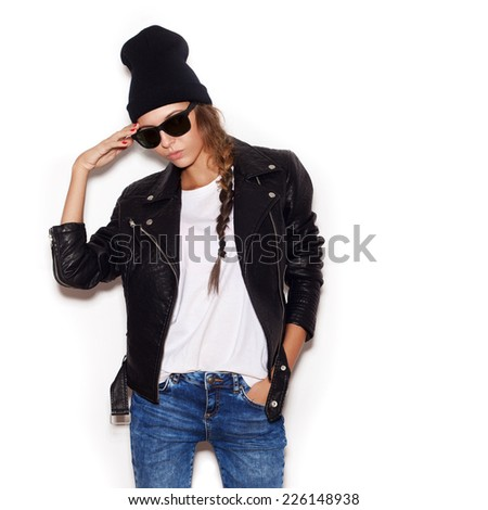 Young woman in sunglasses and black leather jacket and beanie.  White background, not isolated - stock photo