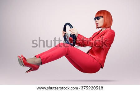 Young woman in sunglasses driver car with a wheel, auto concept - stock photo