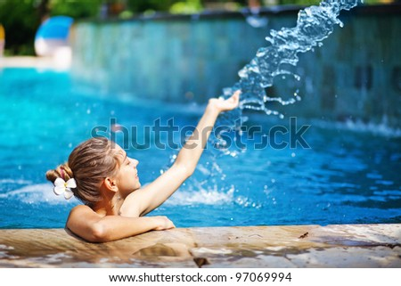 young woman in swimming pool - stock photo