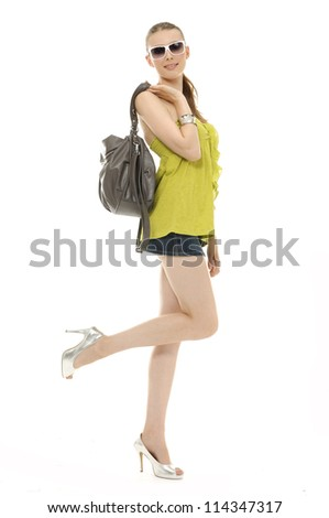 young woman in t-shirt, short skirt and sunglasses, with leather handbag,