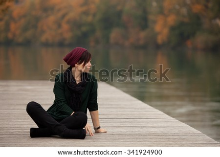 Young woman in the autumn park - stock photo
