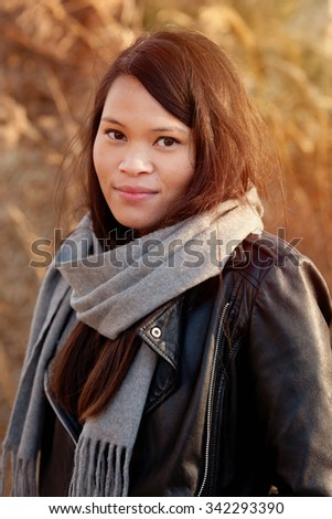 Young woman in the autunm park - stock photo