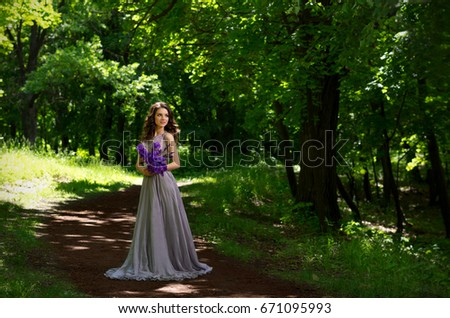 Young woman in the forest (version without sunrays)