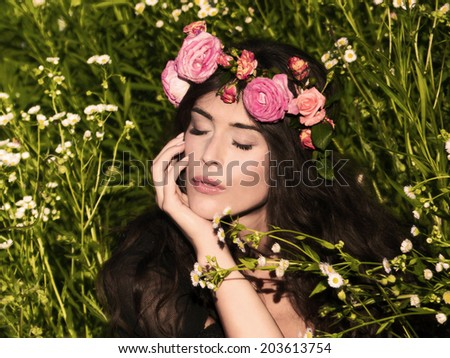 young woman in the grass enjoy in evening sun - stock photo