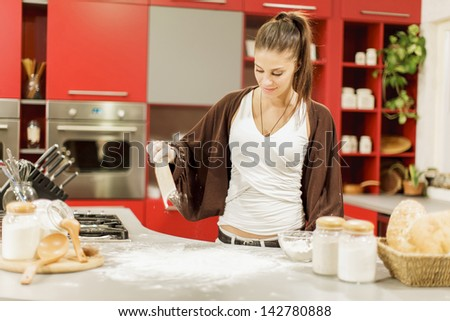 Young woman in the kitchen - stock photo