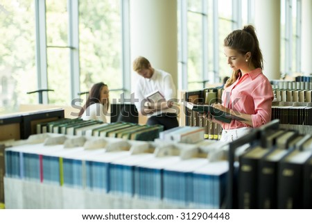 Young woman in the library - stock photo