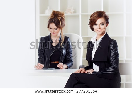 Young woman in the office with a colleague - stock photo