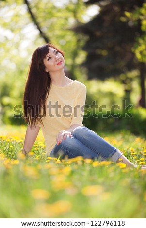 Young woman in the park with flowers
